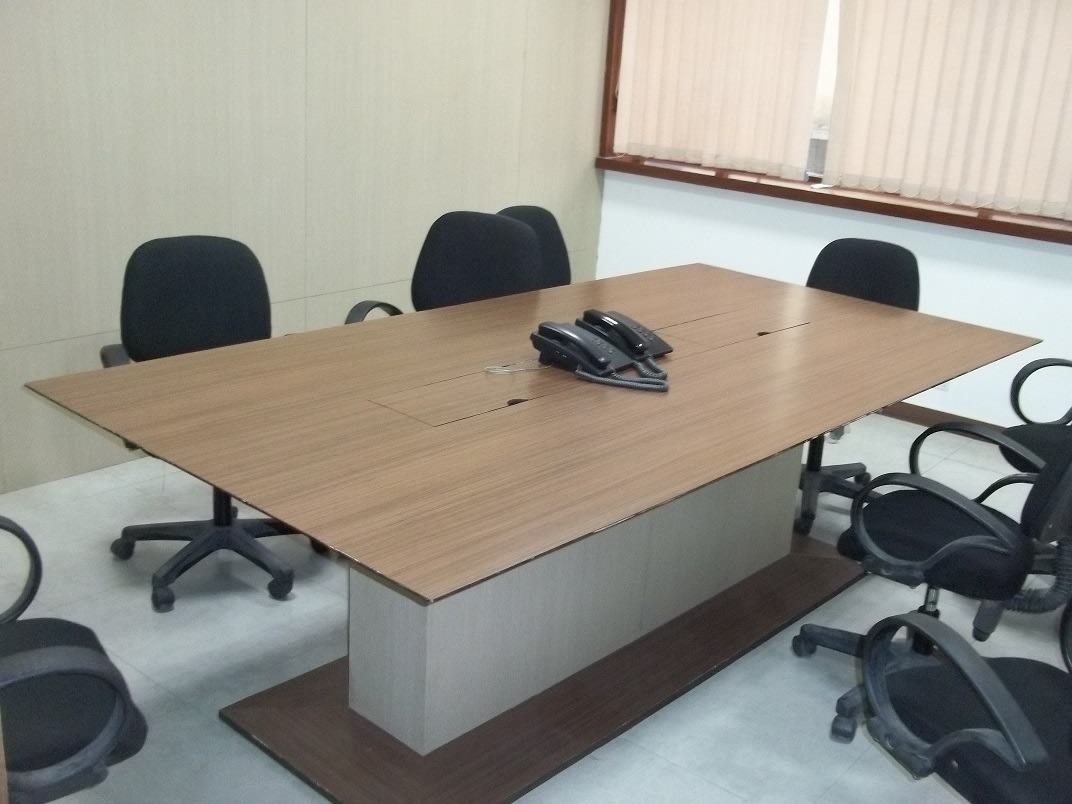 Meeting Room With Simple Furnished Table And Chair by Abhinav Jain | Interior Design Photos & Ideas