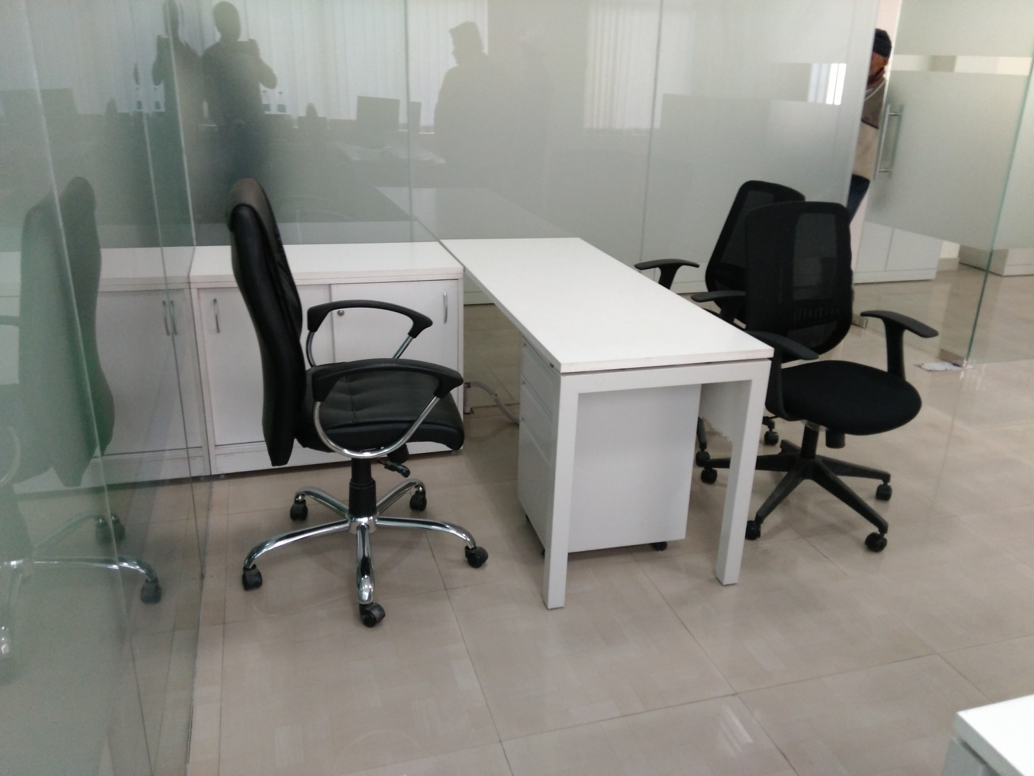 Meeting Room With White Table And Black Chair by Abhinav Jain | Interior Design Photos & Ideas