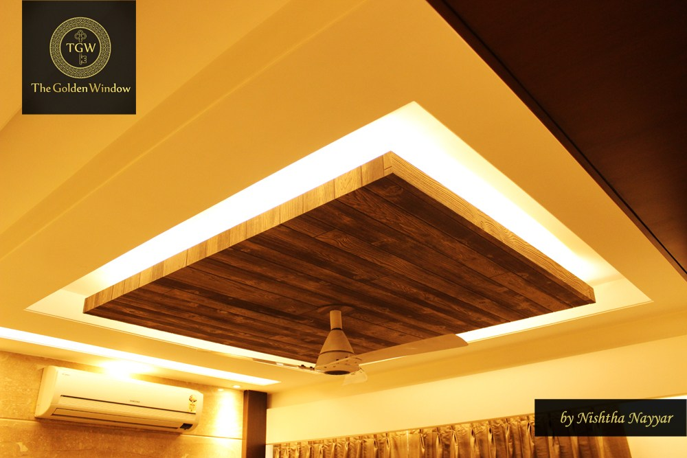 A wooden false ceiling! by Chanana Enterprises Living-room | Interior Design Photos & Ideas