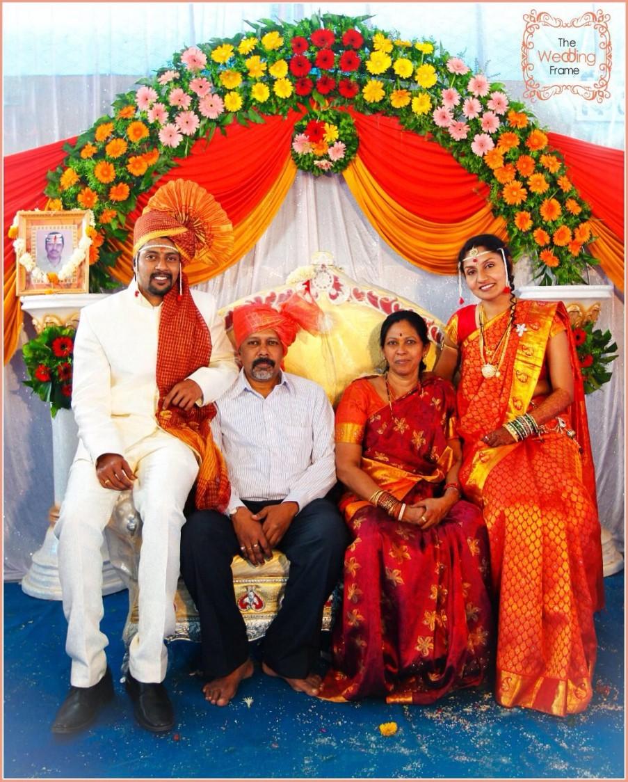 Bride and Groom Family Shot Against Floral Decor by The Wedding Frames Wedding-photography | Weddings Photos & Ideas