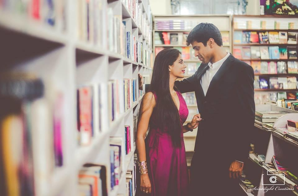 Bride and Groom-To-Be Posing Amongst The Books by Gracian Wedding-photography | Weddings Photos & Ideas