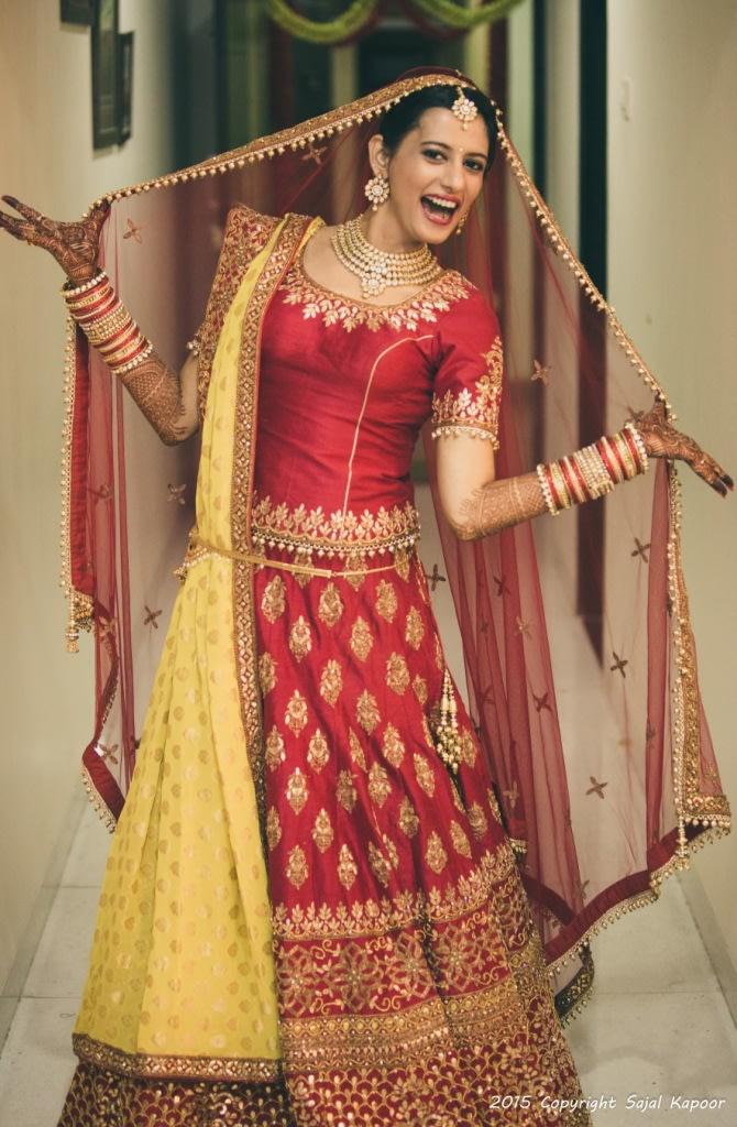 Happy Bride Wearing a Crimson Red Lehenga With Zardozi Work by Sajal Kapoor Wedding-photography Wedding-dresses | Weddings Photos & Ideas