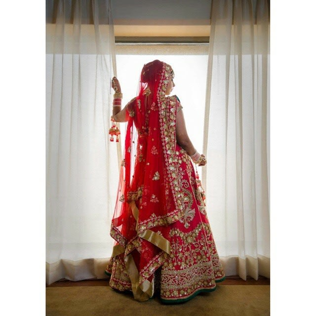 Bride Wearing Crimson Red Lehenga With Zardozi Work by Conscious Cinematic Arts Wedding-photography Wedding-dresses | Weddings Photos & Ideas