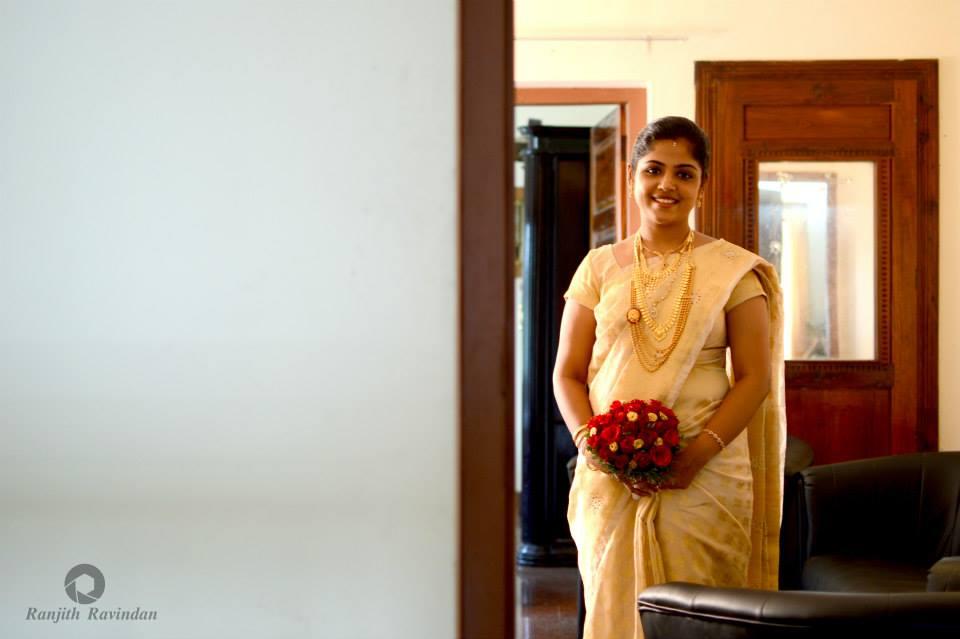 Elegant Christian Bride Holding Red Bouquet by Ranjith R Ravindran Wedding-photography | Weddings Photos & Ideas