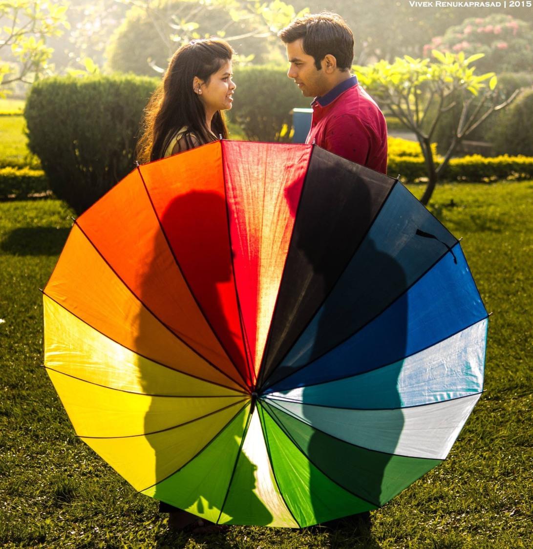 Bride and Groom To-Be Pose With Colourful Umbrella by Vivek Renukaprasad Wedding-photography | Weddings Photos & Ideas