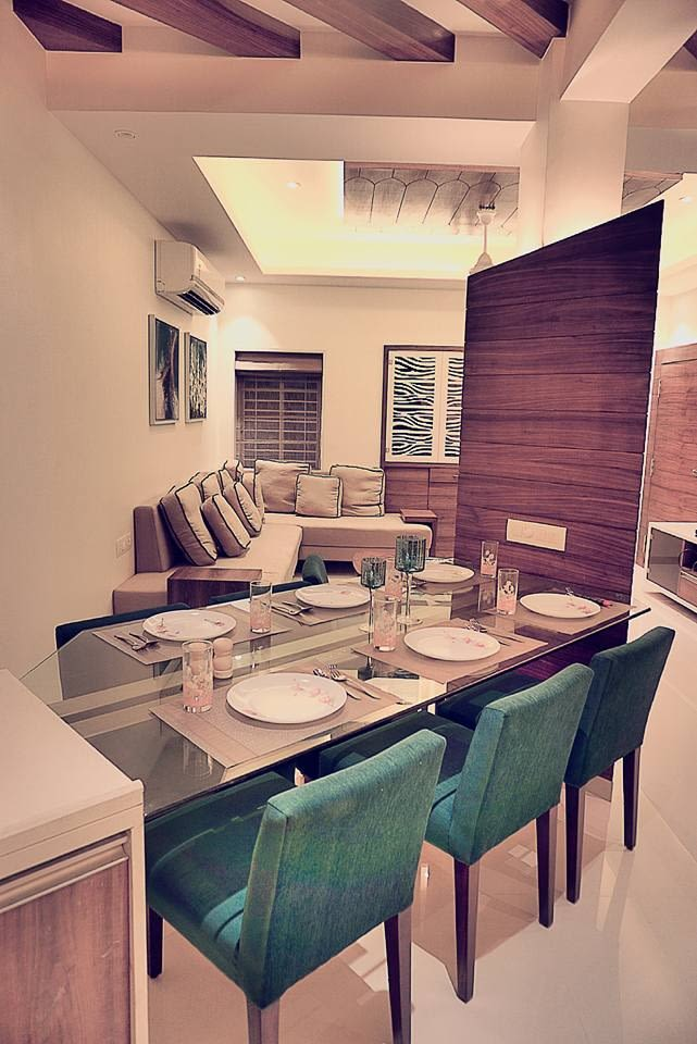 Dining Room With Plush Chairs And Glass Top Table by Mitul Shah Dining-room Contemporary | Interior Design Photos & Ideas