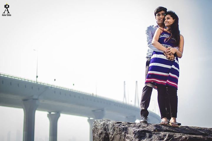 Bride and Groom To-Be Posing Against Bridge Backdrop by Ashraff Shariff Wedding-photography | Weddings Photos & Ideas