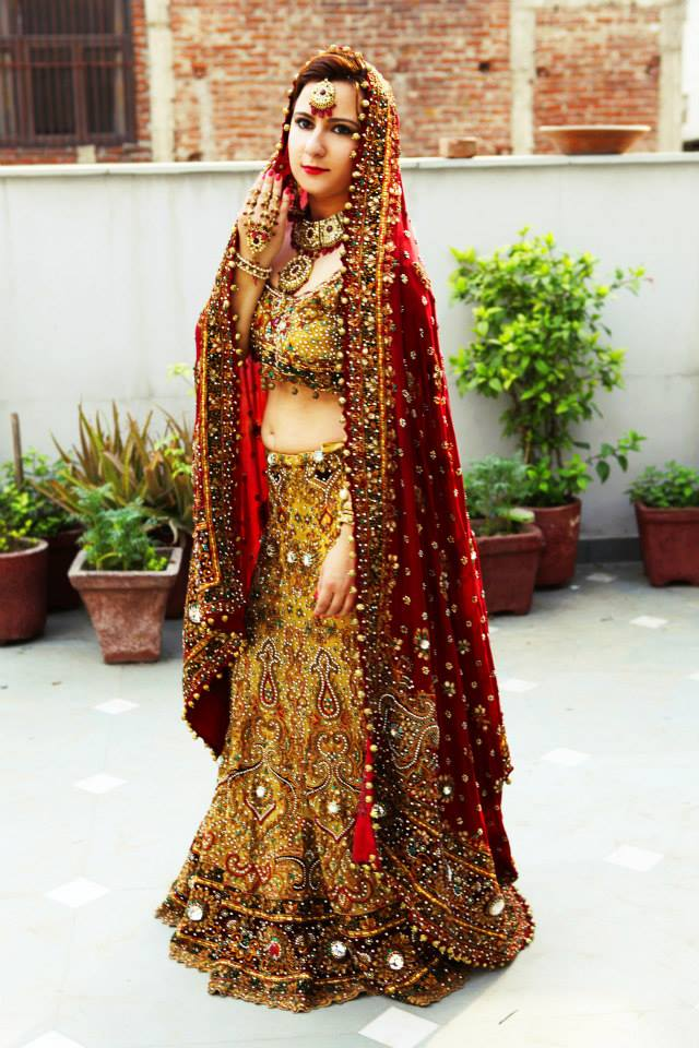 Bride Wearing Maroon and Yellow Heavy Mirror Work Lehenga by Nitin Tanwar Wedding-dresses | Weddings Photos & Ideas