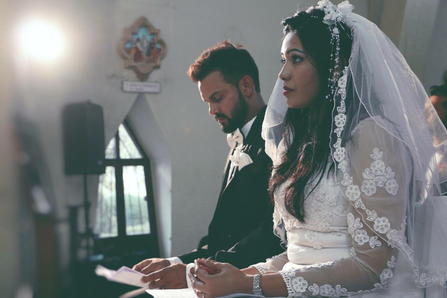 Christian Bride and Groom Taking Wedding Vows by Sagar Thackar Wedding-photography   Weddings Photos & Ideas
