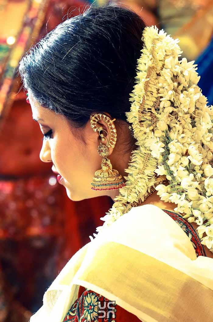 Stunning gajra hairtsyle and gold earrings by Madhuri Sharma Photography Wedding-photography | Weddings Photos & Ideas