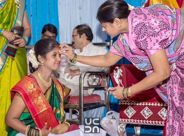 Bride receiving blessings by Madhuri Sharma Photography Wedding-photography | Weddings Photos & Ideas