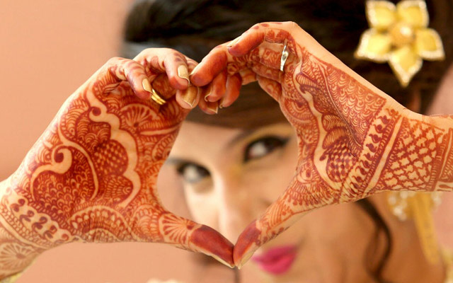 Bride Doing The Heart Pose During Her Engagement by Kshitij Gupta Wedding-photography | Weddings Photos & Ideas