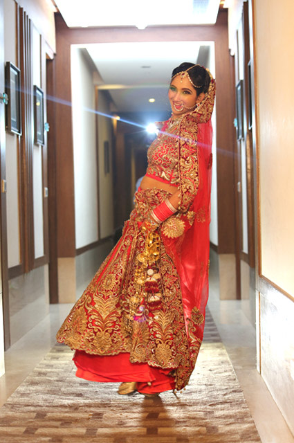 Bride Looking Regal in Crimson Red Lehenga With Heavy Golden Embroidery by Kshitij Gupta Wedding-dresses | Weddings Photos & Ideas