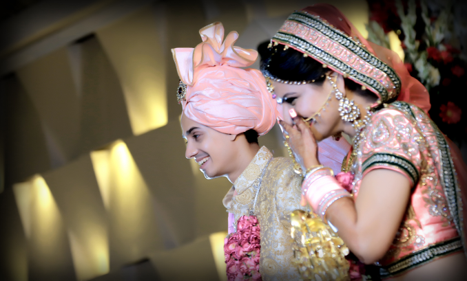 Stunning peach themed wedding outfits for bride and groom by Krishna Studio Wedding-photography | Weddings Photos & Ideas