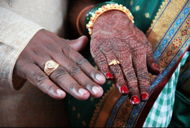 Beautiful hand shot portraying mehendi design and  gold rings by vishal Wedding-photography | Weddings Photos & Ideas