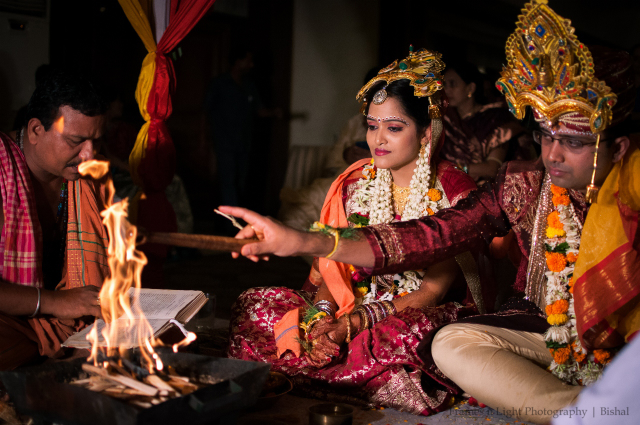 Bride and groom during their wedding ceremony by Frames n Light Photography - Bishal Wedding-photography   Weddings Photos & Ideas