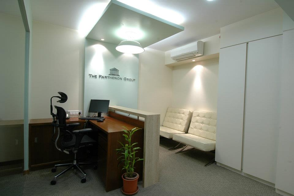 Office Reception Area With Wooden Desk And White Sofa by Hoshedaar Eruch Carnac Modern | Interior Design Photos & Ideas