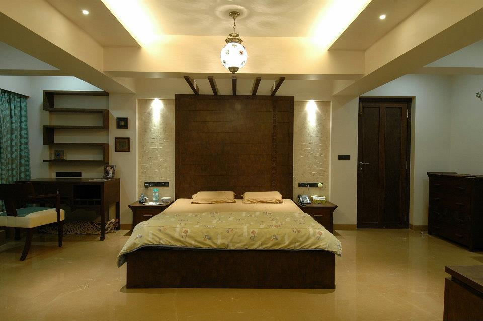 Beige and Brown Bedroom With False ceiling And Wooden Wall Art by Hoshedaar Eruch Carnac Bedroom Contemporary | Interior Design Photos & Ideas