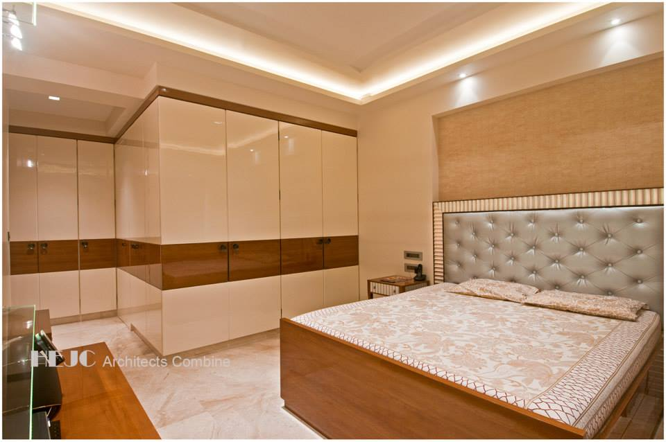 Cream And Brown Bedroom  With Wardrobe  And Wall Art by Hoshedaar Eruch Carnac Bedroom Contemporary | Interior Design Photos & Ideas