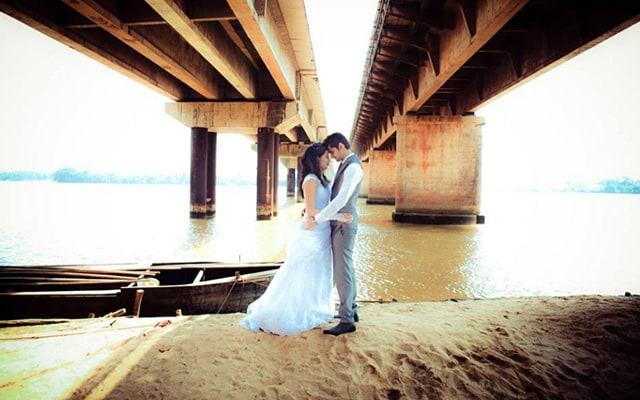 Bride and Groom Strike a Romantic Pose Under the Bridge by Bosco Naveen Wedding-photography | Weddings Photos & Ideas
