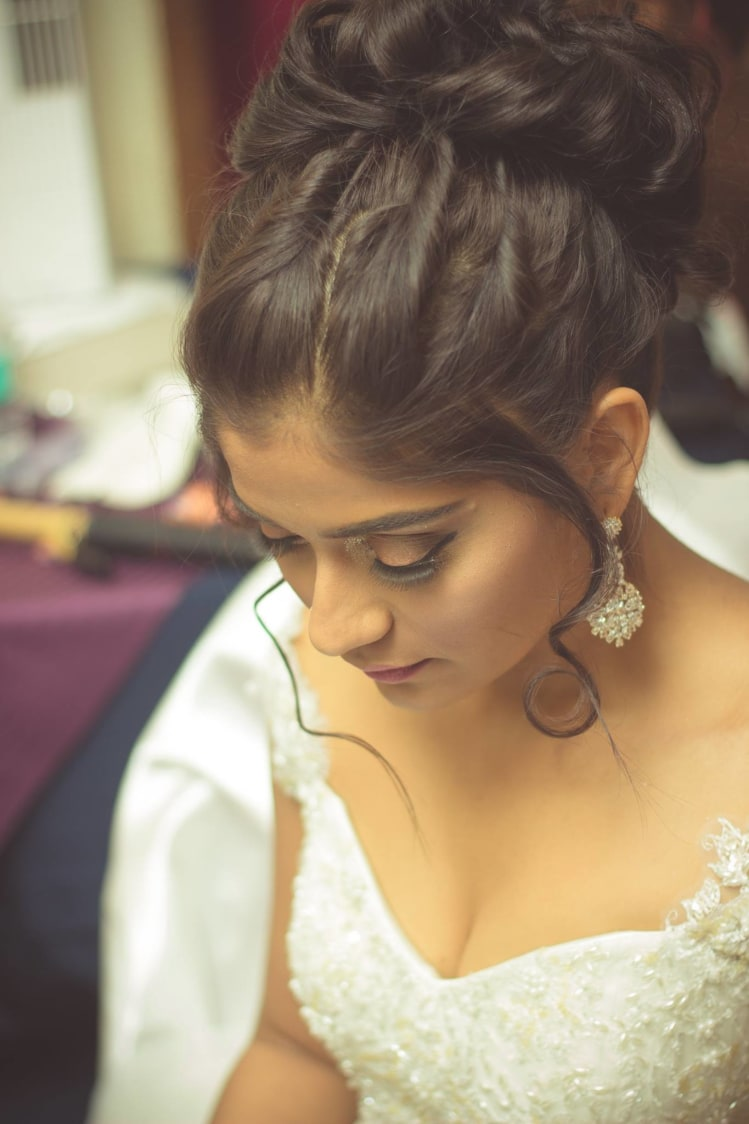 Twisted Bridal Bun With Front Fringes Goes Well With Smoky Eyes by Bosco Naveen Bridal-makeup Wedding-hairstyles | Weddings Photos & Ideas