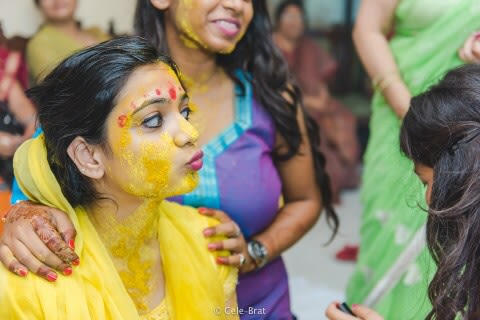Fun mood of bride during haldi ceremony by Cele-brat Wedding-photography | Weddings Photos & Ideas