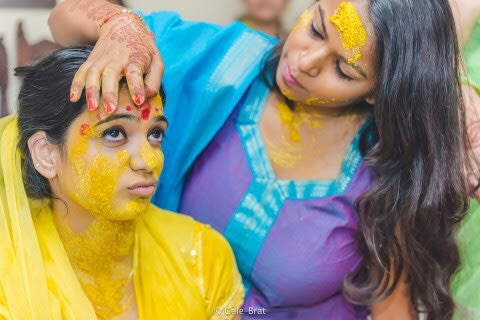 Candid pose of the bride during haldi cermony by Cele-brat Wedding-photography | Weddings Photos & Ideas