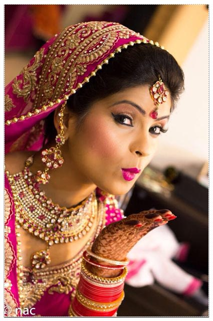 Bride Adoring Beautiful Bridal Makeup by Neha Arora Wedding-photography Bridal-jewellery-and-accessories Bridal-makeup | Weddings Photos & Ideas