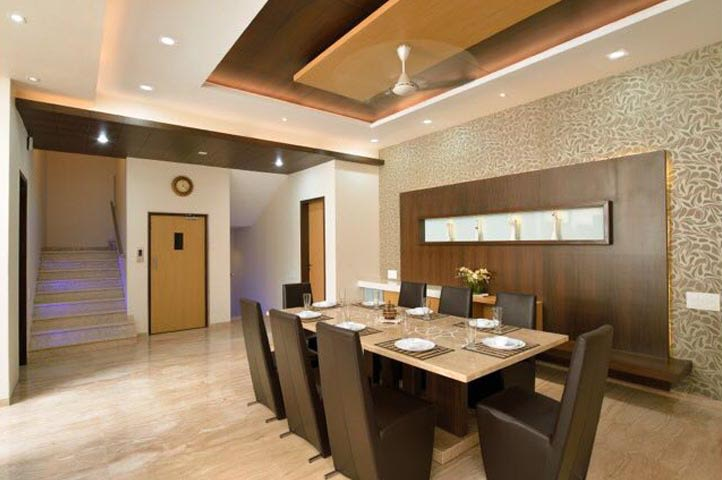 Dining Area With Dark Chocolate High Back Chairs And False Ceiling by Ar.Nitin j Kshirsagar Dining-room Contemporary | Interior Design Photos & Ideas