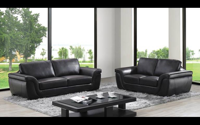 Spacious Living Area With Tufted Sofa And Soft Rug by Swagita Modern | Interior Design Photos & Ideas