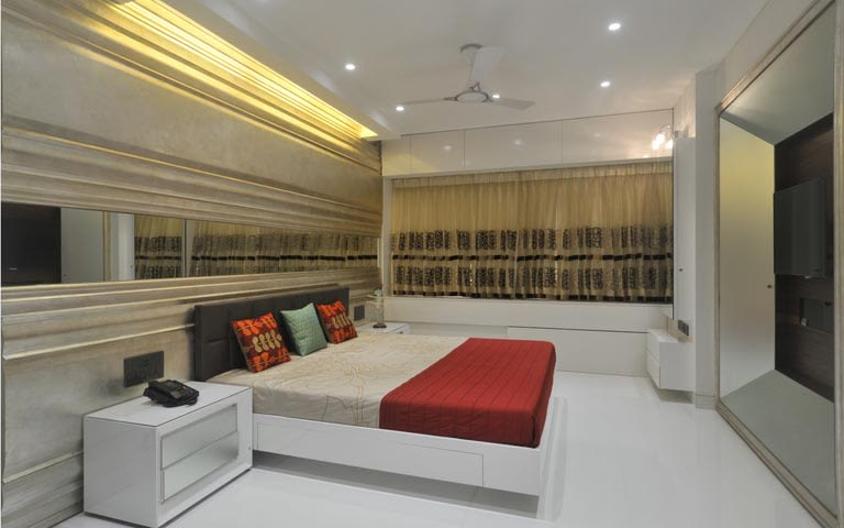 Modern gold and red themed bedroom decor by ARCHITECT KAUSHAL CHOUHAN Bedroom | Interior Design Photos & Ideas