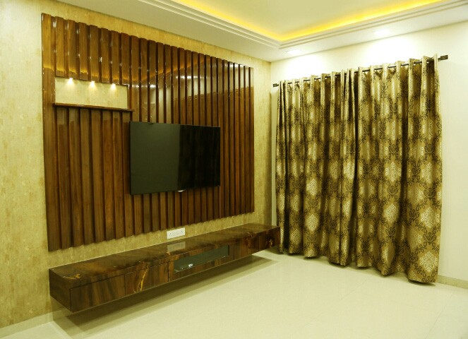 Golden theme modern TV cabinet decor by Amitus EPC Projects Pvt Ltd Living-room | Interior Design Photos & Ideas
