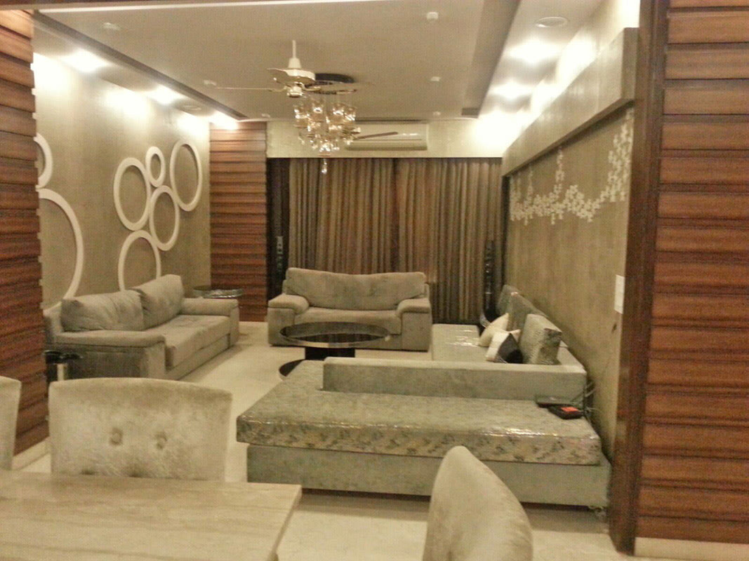 Cement Grey Sofa Set with Wall Art and Chandelier by Ar. Barkha Jain Living-room Modern | Interior Design Photos & Ideas