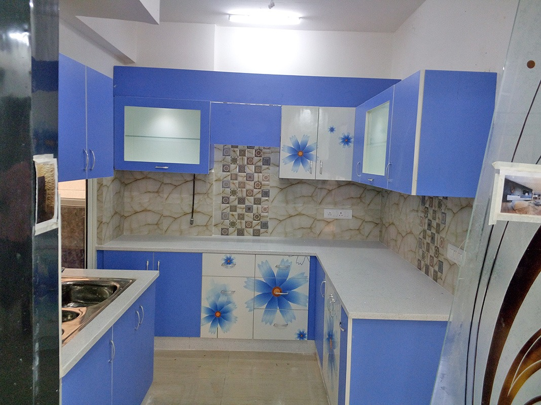 L shaped Kitchen with Blue and White theme and Floral Designs on Cabinets by Ar. Barkha Jain Modular-kitchen Modern | Interior Design Photos & Ideas
