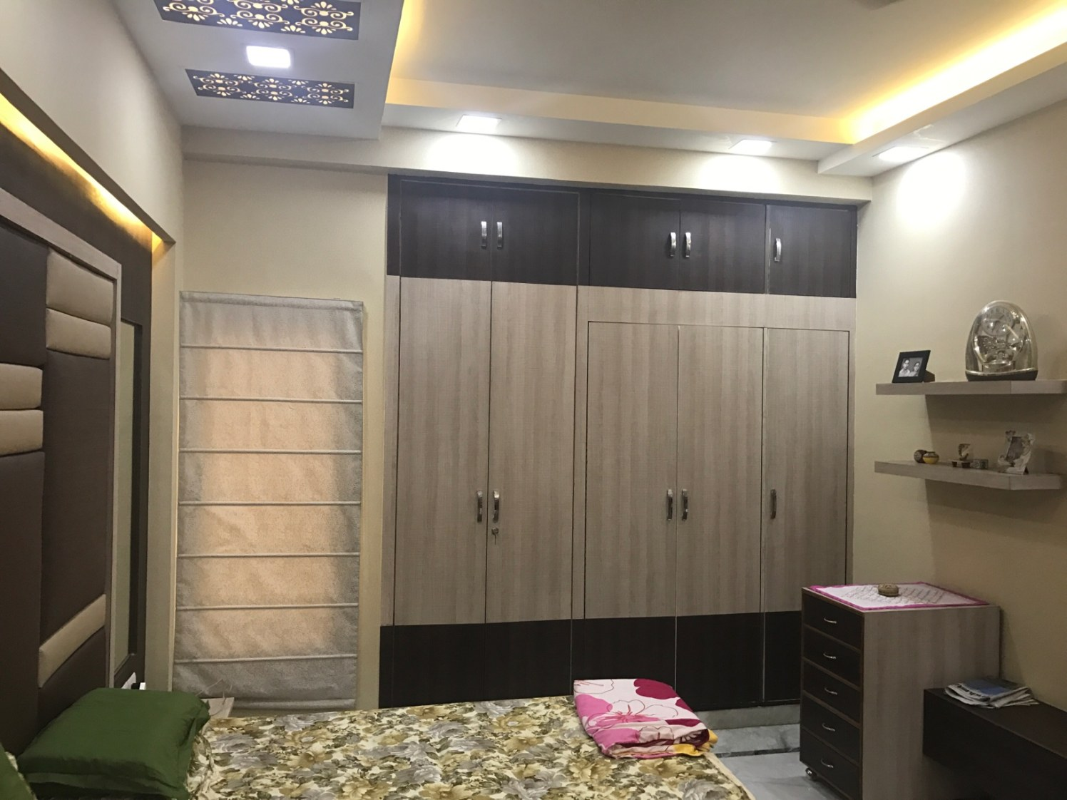 Sophisticated bedroom Space with Wooden Wardrobe and False Ceiling by Ar. Barkha Jain Bedroom Modern | Interior Design Photos & Ideas