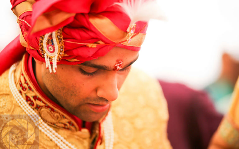 Red urban With  A Feather Brooch by Viral Shah  Groom-wear-and-accessories | Weddings Photos & Ideas