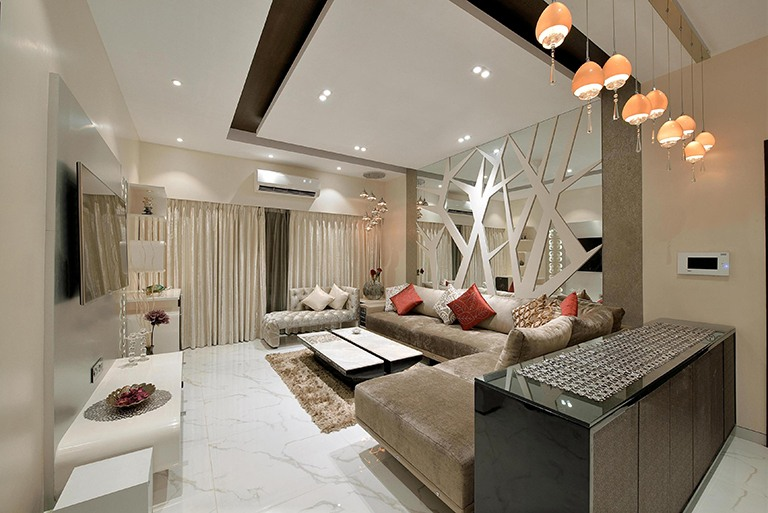 A Spacious White Living Room With Sectional Sofa by Megha Jain Living-room Contemporary | Interior Design Photos & Ideas