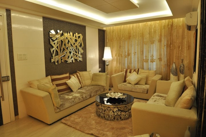 An Elegant Living Room With Off White Sofa by Decor Dreams Living-room | Interior Design Photos & Ideas