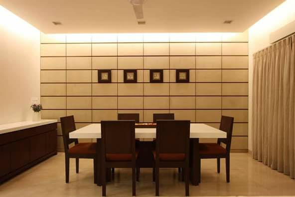 An Elegant Dining Room With Tank Beige Walls And Wooden Furniture by Megha Jain Dining-room Modern | Interior Design Photos & Ideas