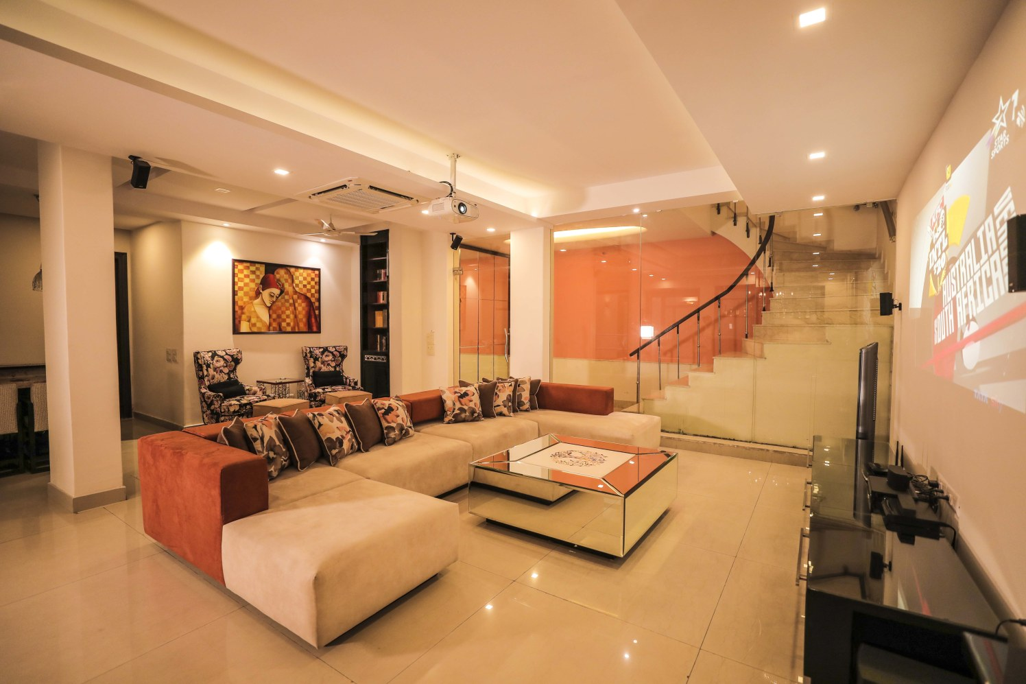 Orange themed living room decor by Bhoomi Ink Architects Living-room Modern | Interior Design Photos & Ideas