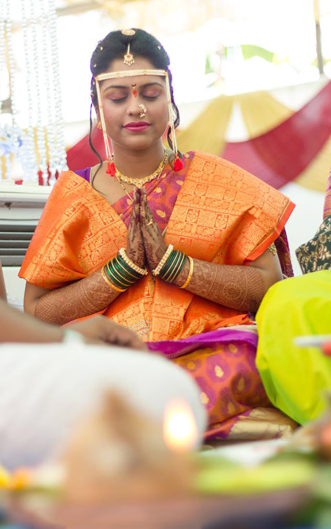 A candid picture of the bride praying by Pankaj Rokade Photography  Wedding-photography | Weddings Photos & Ideas