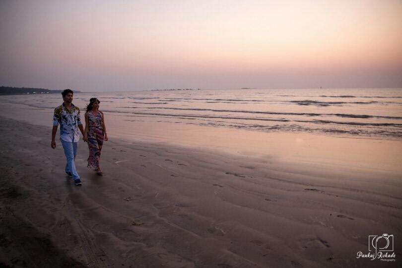 The couple taking a romantic walk at the beach by Pankaj Rokade Photography  Wedding-photography | Weddings Photos & Ideas