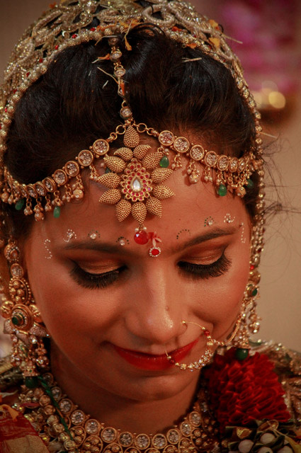 The Gorgeous bride glances down by Saurabh Photography Wedding-photography | Weddings Photos & Ideas