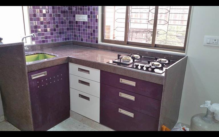 L-shaped modular kitchen with a purple theme by Burhani Design Studio Modular-kitchen Modern | Interior Design Photos & Ideas