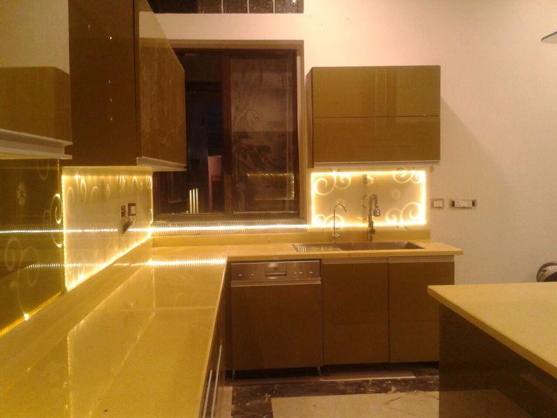 A modern G shaped modular kitchen by Bella Cucina Consultancy Modular-kitchen | Interior Design Photos & Ideas