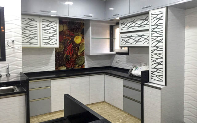 L-shaped Modular Kitchen With Modern Abstract Patterned Cabinets by Vikesh M Sheth Modular-kitchen Modern | Interior Design Photos & Ideas