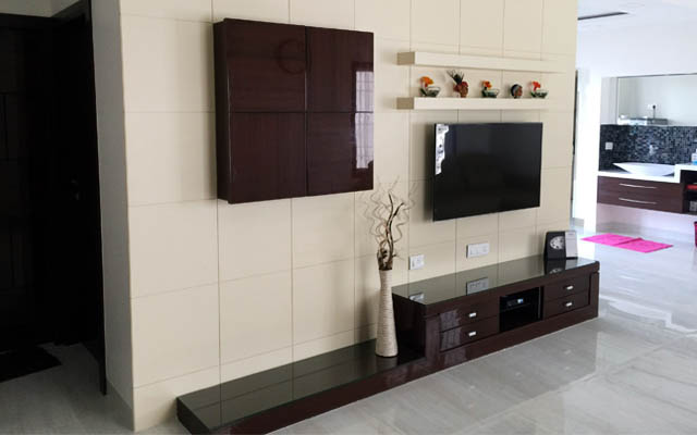 White Tile TV  Cabinet Decor With Black Detailing by Vikesh M Sheth Living-room Modern | Interior Design Photos & Ideas