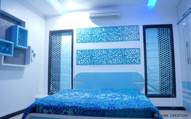 Blue and White Themed Bedroom With Blue Pattern Detailings by Vikesh M Sheth Bedroom Modern | Interior Design Photos & Ideas