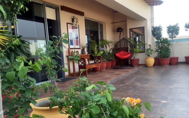 Veranda Decor With Wooden Tiles and Porch Chair by Ram Malhotra Open-spaces Modern | Interior Design Photos & Ideas