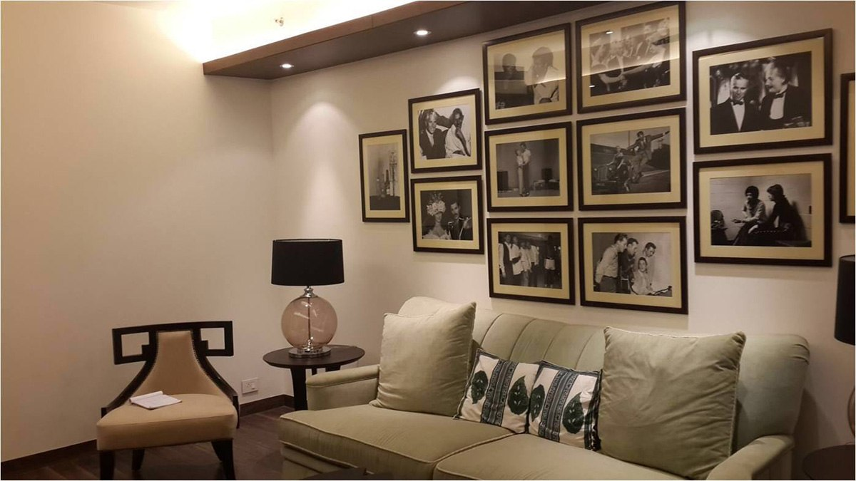 Tan Colored Velvet Sofa With Pictures on Wall by Ram Malhotra Modern | Interior Design Photos & Ideas